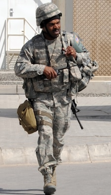 Tech. Sgt. Andre Scott of the 380th Expeditionary Security Forces Squadron runs carries his gear during a security forces training exercise Feb. 20, 2010, at a non-disclosed base in Southwest Asia.  Sergeant Scott is deployed from the 436th Security Forces Squadron at Dover Air Force Base, Del. The 380th ESFS, as part of the 380th Air Expeditionary Wing, supports operations Iraqi Freedom and Enduring Freedom and the Combined Joint Task Force-Horn of Africa. (U.S. Air Force Photo/Master Sgt. Scott T. Sturkol/Released)