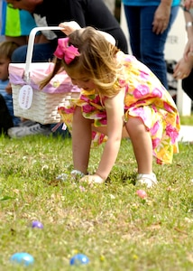 Karley Bordeaux enthusiastically picks up her first egg at the Easter egg hunt on Joint Base Charleston, S.C., April 3, 2010. The hunt, located in the fields behind the commissary, was littered with eggs for each age group. The eggs were filled with candy and coupons for the commissary donated on behalf of JB CHS.  Karley is the daughter of Tech. Sgt. Harold Bordeaux who is a loadmaster with the 17th Airlift Squadron. (U.S. Air Force Photo/Airman 1st Class Lauren Main)