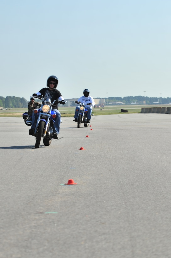 SEYMOUR JOHNSON AIR FORCE BASE, N.C. -- Airman 1st Class Crystal Sanders and Mr. Winford Ulmer weave between cones during the Basic Riders Course here, April 6, 2010. This portion of the course teaches riders how to control their speed while maneuvering their bikes. Airman Sanders, 4th Logistics Readiness Squadron traffic management officer, hails from Al Toona, Pa. Mr. Ulmer, 335th Fighter Squadron resource advisor, is from Detroit. (U.S. Air Force photo/Senior Airman Rae Perry)