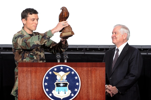 Cadet 1st Class Andrew J. VanTimmeren presents the U. S. Secretary of Defense  Robert Gates with the Bird after addressing the Cadet Wing in Arnold Hall theater on April 2.  Secretary Gates spent the day teaching and lecturing cadets at the United States Air Force Academy in Colorado Springs, CO. Dr. Gates has held the office of Secretary of Defense since Dec 18, 2006 and has served in one form or another under eight U.S. Presidents. (Air Force Photo/ Johnny Wilson)