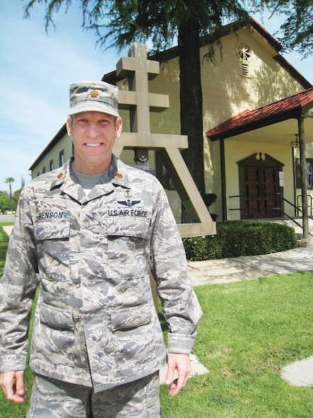 Chaplain (Maj.) Craig Benson stands in front of the base chapel at March Air Reserve Base, April 2.  Chaplain Benson arrived at March ARB last month and is the first of six new Active Guard Reserve chaplains assigned to the most active bases across the United States. (U.S. Air Force Photo/2nd Lt. Zach Anderson)