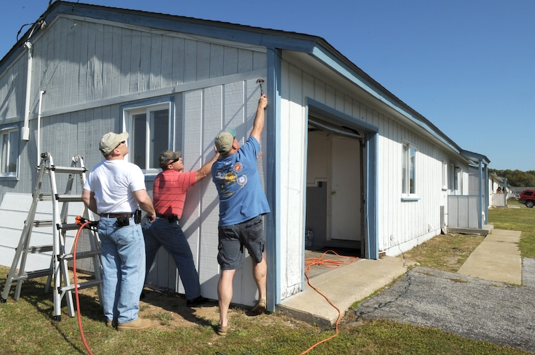 FORT FISHER RECREATION AREA, N.C -- Volunteers from Seymour Johnson Air Force Base nail new siding onto cottages here, April 7, 2010. Before it closed in the late 1980's, Fort Fisher was an Air Force radar complex. (U.S. Air Force photo/Staff Sergeant Courtney Richardson)