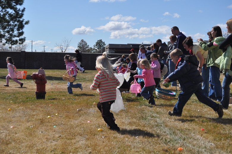 Children of Utah Air National Guard members race to find Easter eggs during the ANG's annual Children's Easter Egg Hunt March 27. Hundreds of Air Guard children attended the event, which included a magic show, egg hunt and hot dog lunch.  U.S. Air Force photo by Lindsey Cheetham.
