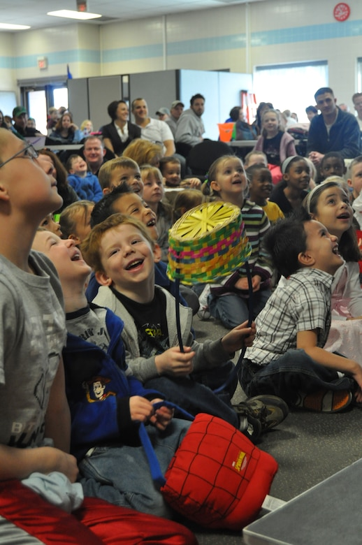 Children of Utah Air National Guard members eagerly await the arrival of Christopher Fair the magician at the ANG's annual Children's Easter Egg Hunt March 27. Hundreds of Air Guard children attended the event, which included a magic show, egg hunt and hot dog lunch.  U.S. Air Force photo by Lindsey Cheetham.