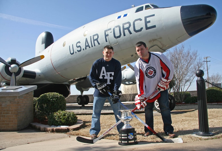 This month will mark the second time for the 552nd ACW Canadian Detachment to meet their American 552nd counterparts on the ice. American team captain Jim Behn, left, and Canadian team captain James McCarrron will lead the head to head hockey clash for the second annual 552nd ACW Can-Am Cup. (Air Force photo by John Stuart)