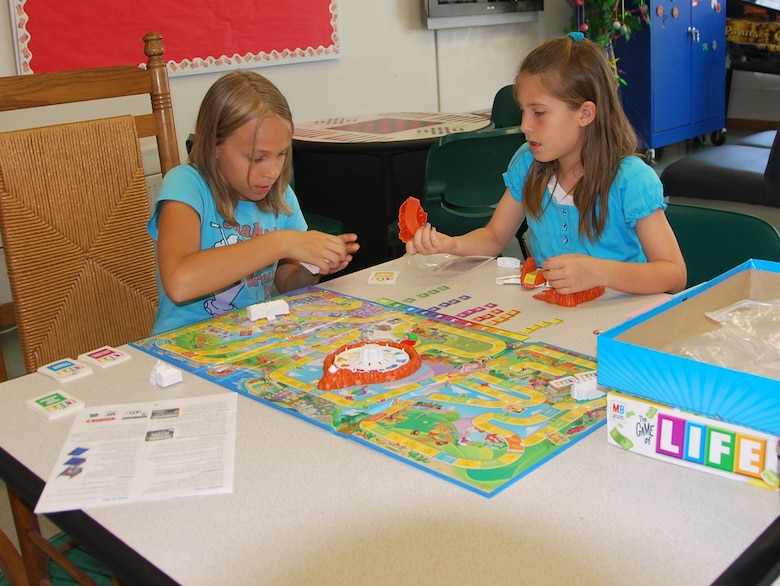 Jessika Collie, 11 (left) and Jaelyn Derrickson, 9, play the game Life at Patrick's School Age Program during their spring break from school. The SAP is open for children 5 to 12 years old and was recently given the Counsel on Accreditation stamp of approval for meeting national standards for operating school age programs. (U.S. Air Force photo/Tech. Sgt. Tom Czerwinski)