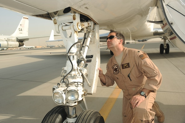 Navy Cmdr. Rich Ross, 379th Expeditionary Operations Group C-20 pilot, conducts a pre-flight inspection on a C-20 aircraft before takeoff at an air base in Southwest Asia, March 31, 2010. (U.S. Air Force photo by Tech. Sgt. Michelle Larche)