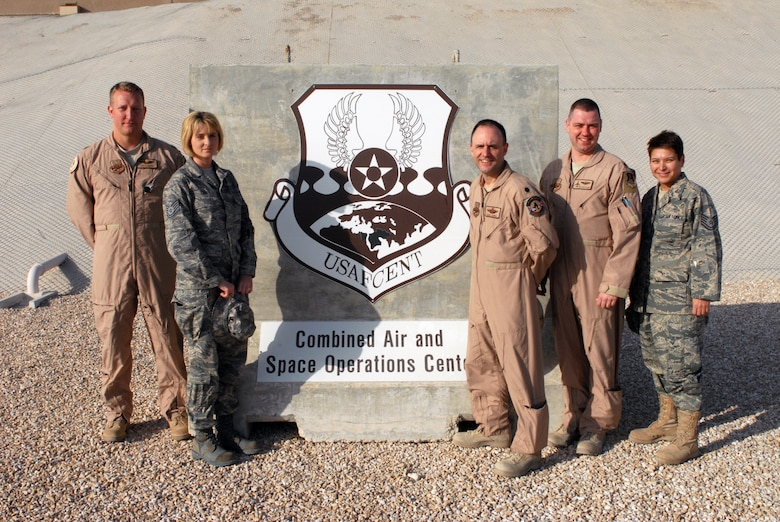 Maj. John Saunders, Tech. Sgt. Carmaleta Lane, Lt. Col. Herbert Ludwig, Maj. Richard Mastalerz and Tech. Sgt. Marie Colomer, all of the 103rd Air and Space Operations Group, take a moment from their duties to pose for a group photo outside the U.S. Air Force Central's Combined Air and Space Operations Center in Southwest Asia. The five members of the Connecticut Air National Guard are reaching the end of successful deployments in direct support of the command and control of airpower throughout Iraq, Afghanistan and 18 other nations.  (U.S. Air Force photo by Senior Airman Dillon White, USAFCENT Public Affairs)
