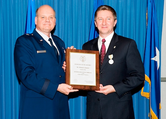 Brig. Gen. Dana Simmons, OSI/CC, hosted an induction ceremony for OSI's newest executive director, Mr. Michael Janosov, SES, March 19, in the AFOSI Headquarters rotunda. Mr. Janosov is AFOSI's fifth executive director.  He replaces Mr. Doug Thomas who retired last year. (U.S. Air Force photo/Mr. Mike Hastings)