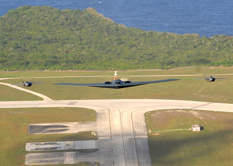 Two F-22 Raptors and one B-2 Spirit deployed to Andersen Air Force Base, Guam, from the 90th Expeditionary Fighter Squadron and the 13th Expeditionary Bomb Squadron recently flew in formation over Andersen. The F-22 Raptor and B-2 Spirit deployment to Andersen marks the first time, F-22 Raptors and B-2 Spirits, the key strategic stealth platforms in the Air Force inventory, deployed together outside the continental United States.  As part of the continuing force posture adjustments to address worldwide requirements, the United States continues to deploy additional forces likethe F-22 and B-2 throughout the Western Pacific. This is the latest exampleof the flexibility U.S. forces have to meet their ongoing commitments andsecurity obligations throughout the Pacific region.(U.S. Air Force photo/ Master Sgt. Kevin J. Gruenwald) released