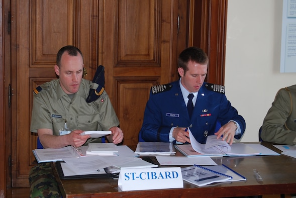 Cadet 1st Class Charlton Coats works with his Swiss teammate, Capt. Mathias Ledermann, at an international service academy Law of Armed Conflict competition in San Remo, Italy, during spring break.  Cadet Coats won the top individual award and the best mixed team award for his work with Captain Ledermann on their mock country, St. Cibard (Photo by Patrizia di Pietro)