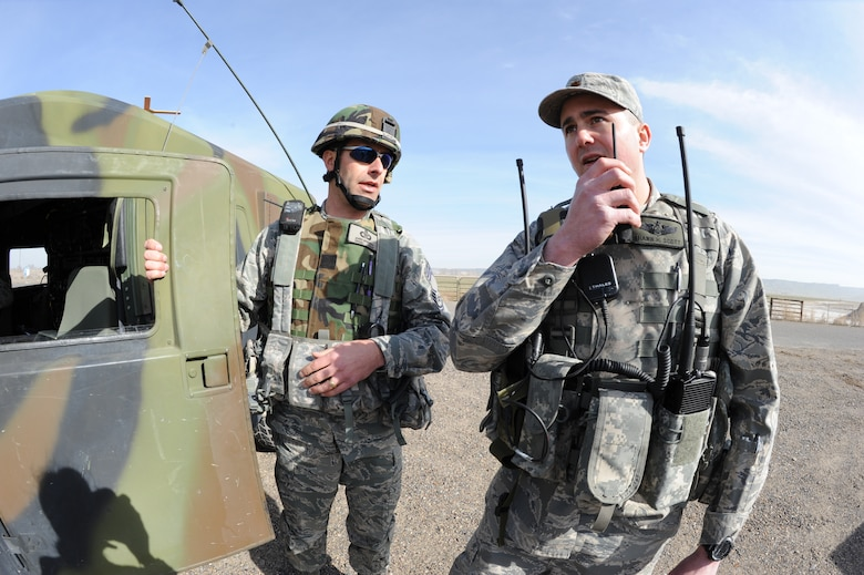 Chief Master Sgt. James McMonigal, left, and Maj. Shawn Scott, both of the Idaho Air National Guard 124th Air Support Operations Squadron participate in training in Grandview, Idaho, March 16, 2010. 124 ASOS members are training in a simulated attack by coordinating various aircraft to provide support to ground forces, including AH-64 Apache gunships, A-10 Thunderbolt II's, and F-15 Strike Eagles.
