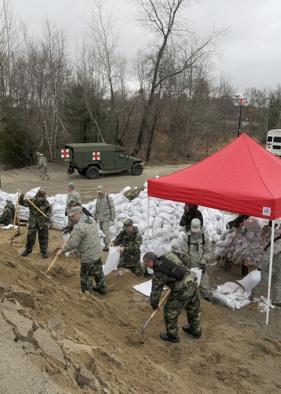 Members of the 104th Fighter Wing, Massachusetts Air National Guard, activated in support of Operation RISING WATER, fill thousands of sandbags on March 31, 2010 to be used in impacted areas threatened by flooding during recent rain storms.