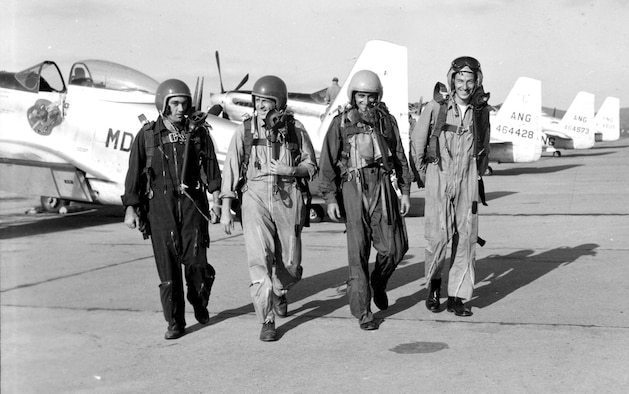 (Left to right) Guardian Angels pilots Capt. John F.R. Scott, 1st Lt. Malcolm Henry, 1st Lt. Bill Marriott and Capt. Jesse Mitchell on the flight line at Spaatz Field in Reading, Pa., following an airshow at Fort Indiantown Gap, Pa., in 1952. The Guardian Angels, a Maryland Air National Guard aerial demonstration team, flew from 1952 to 1953. (Released)