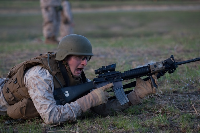 A Marine from  2nd Battalion, 25th Marine Regiment, 4th Marine Division, Marine Forces Reserve, shouts commands to his Marines as they advance through a live-fire course in Quantico, Va., April 10.