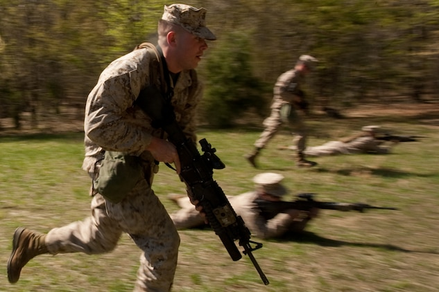 A Marine from Company G, 2nd Battalion, 25th Marine Regiment, 4th Marine Division, Marine Forces Reserve, practices combat rushing during a field exercise in Quantico, Va., April 10.
