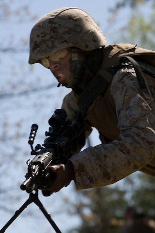 A Marine from 2nd Battalion, 25th Marine Regiment, 4th Marine Division, Marine Forces Reserve, practices combat rushing during a field exercise in Quantico, Va., April 10.