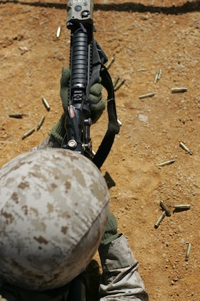A Marine from 2nd Battalion, 25th Marine Regiment, 4th Marine Division, Marine Forces Reserve, fires his rifle during a field training exercise in Quantico, Va., April 10.