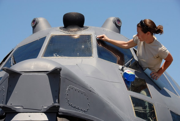 Air Force Reserve Staff Sgt. Tiffany Martinez, 919th Aircraft Maintenance Squadron, cleans the windscreen on a 919th Special Operations Wing MC-130E Combat Talon I aircraft parked on the Eglin Air Force Base tarmac April 9.  Duke Field reservists and their static display aircraft participated in Eglin's 75th Anniversary Open House and Air Show April 10-11 which attracted more than 70,000 daily spectators from the local area and beyond. (U.S. Air Force photo/Tech. Sgt. Samuel King Jr.)