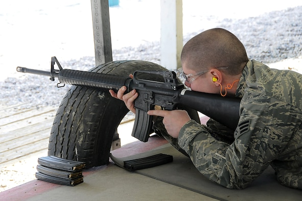 Senior Airman Bobby Foreman, 151st Civil Engineer Squadron, prepares to shoot his M-16 during weapons training on April 10. Airman Foreman is in the Combat Arms Training and Marksmanship class. (U.S. Air Force photo by Staff Sgt. Emily Monson)