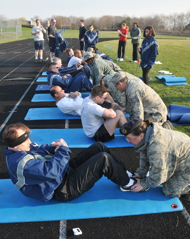 MILWAUKEE -- Airmen from the 128th Air Refueling Wing perform their annual physical training test at Cudahy High School on the morning of Saturday, April 10, 2010.    The PT test was one of the wing's last testing sessions before the new Air Force fitness standards come into effect in July.