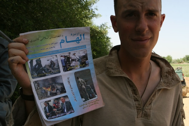 Lance Cpl. Richard A. Louke a mortarman with 81 mm Mortar Platoon, Weapons Company, 1st Battalion, 6th Marine Regiment holds a Taliban pamphlet that was left near their guard post in Marjah, Afghanistan, April 13. Marines and Afghan National Army soldiers with 1/6 are taking part in the Marjah Accelerated Agricultural Transition program, which is a project aimed at facilitating the transition from illicit to licit crops.