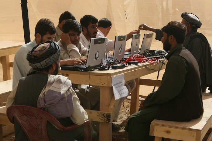 Participants in the Marjah Accelerated Agricultural Transition program register their crops and where they live, at the government center in Marjah, Afghanistan, April 13. Marines and Afghan National Army soldiers with 1st Battalion, 6th Marine Regiment are taking part in the Marjah Accelerated Agricultural Transition program, which is a project aimed at facilitating the transition from illicit to licit crops.