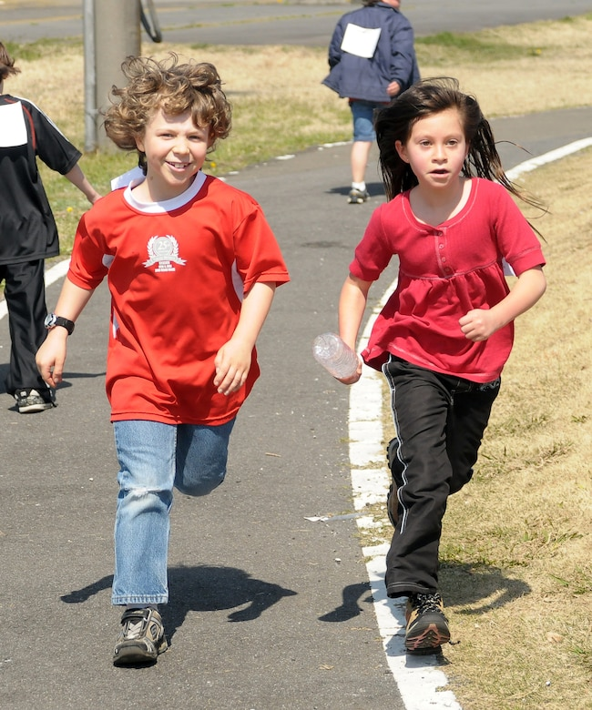 YOKOTA AIR BASE, Japan -- Declan Denny and Pazia Ramirez, both 4th graders,  sprint together during the 2010 Jog/Walk-a-thon, April 8. The Jog/Walk-a-thon was held to raise money for Joan K. Mendel Elementary School. (U.S. Air Force photo/Airman 1st Class Katrina R. Menchaca)