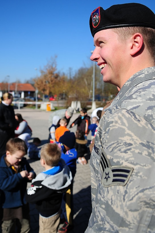 "Senior Airman Truman Smith enjoys a laugh as he volunteers in the child development center's ""Boot Camp Week"" April 7, 2010, at the child development center at Rose Barracks, Vilseck Military Community, Germany. ""Boot Camp Week"" gave servicemembers' children an opportunity to experience some military norms such as physical training, first aid, land navigation and tactical vehicle familiarization in support of the Department of Defense's Month of the Military Child. Airman Smith is a 2nd Air Support Operations Squadron tactical air control party member. (U.S. Air Force photo/Senior Airman Tony R. Ritter)"