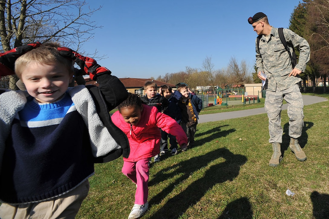 "Airman 1st Class Brian Crabill leads a group of children on a run during the child development center's ""Boot Camp Week"" April 7, 2010, at the child development center at Rose Barracks, Vilseck Military Community, Germany. ""Boot Camp Week"" gave servicemembers' children an opportunity to experience some military norms such as physical training, first aid, land navigation and tactical vehicle familiarization in support of the Department of Defense's Month of the Military Child. Airman Crabill is a 2nd Air Support Operations Squadron tactical air control party member. (U.S. Air Force photo/Senior Airman Tony R. Ritter)"