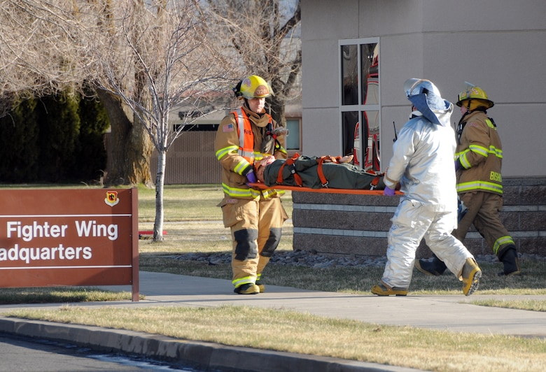 Members of the 173rd Fighter Wing Fire Department carry out a simulated casualty during a base-wide exercise April 6, 2010 at Kingsley Field, Klamath Falls, Ore.  This exercise was designed to prepare members of the base for what would happen in the event of a flood.  (U.S. Air Force Photo by Tech. Sgt. Jennifer Shirar)