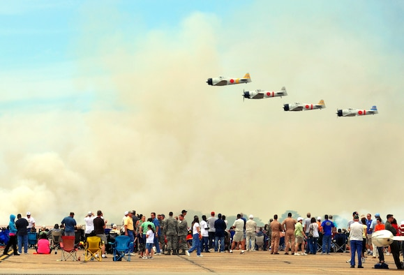 "EGLIN AIR FORCE BASE, Fla. --  A group of T-6 Texans rebuilt as Japanese Zeros re-enact the bombing of Pearl Harbor in 1941 in the ""Tora, Tora, Tora"" show during the 75th Anniversary Air Show April 10. More than 125,000 were in attendance during the air show April 10-11, enjoying a variety of aerial performances and static displays. This was Eglin's first open house since 2007 and was timed to coincide with the 75th anniversary of the installation. The Thunderbirds, Army Black Daggers and an F-22A Raptor demo were some of the highlights of the event. (U.S. Air Force photo/ Airman 1st Class Veronica McMahon)"
