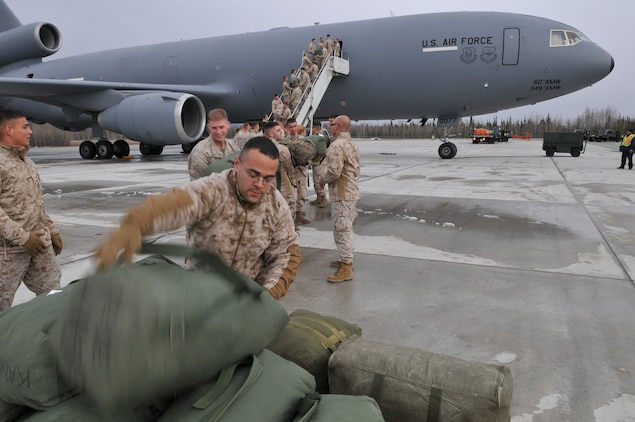 Marines with Marine Attack Squadron 211 unload their gear from a KC-10 on the flight line of Eielson Air Force Base in Alaska after a seven-hour flight from Yuma April 13, 2010. More than 160 Marines from VMA-211 and Marine Aviation Logistics Squadron 13 flew north to participate in Exercise Red Flag-Alaska, one of the largest joint-service exercises in the U.S. military. The Avengers' eight AV-8B Harriers comprise part of the 100 aircraft participating in the exercise.