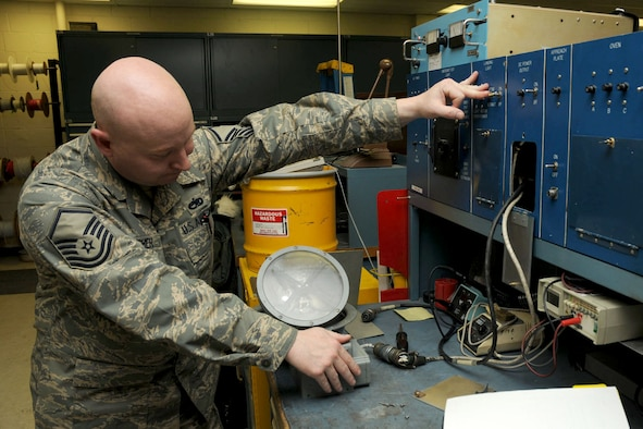 Alaska Air Guardsman MSgt Brian Boucher, an aircraft electrician, repairs a landing gear light for a C-130H aircraft. Boucher works for the Electric Shop of the 176th Maintenance Squadron, Kulis Air National Guard Base, Anchorage, Alaska. The repair of the light falls under the Air Force Repair Enhancement Program (AFREP).  AFREP is a wing-level program that takes throw-away parts and makes them good as new. Unserviceable aircraft parts are carefully scrutinized to see if there is a way to salvage them for less money than it costs to replace them. (Alaska Air National Guard photo by Tech. Sgt. Shannon Oleson)