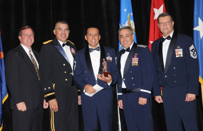 (From the left) Scott Essex, Arizona chairman of Employer Support for the Guard and Reserve, Army Maj. Gen. Hugo E. Salazar, commanding general and Adjutant General of the Arizona National Guard, Senior Master Sgt. Armando Gonzalez, Arizona's Outstanding First Sergeant of the Year, Brig. Gen Michael Colangelo, Arizona Air National Guard commander, and the Arizona Air National Guard Command Chief Master Sgt. Daniel Irving stand for a photo at the state's Outstanding Airman of the Year Banquet, April 9. (Air Force photo by Master Sgt. Kelly Deitloff)