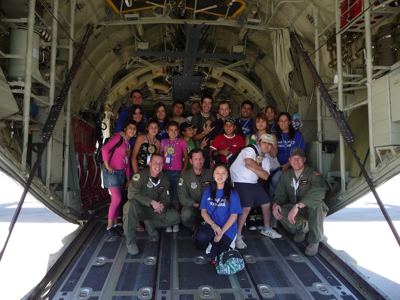 SANTIAGO, Chile -- Children from the Make a Wish Foundation, a charitable organization dedicated to assisting disabled and ill children around the world by creating once-in-a-lifetime memories, pose with members of the Texas Air National Guard during the FIDAE air and trade show in Santiago, Chile.  The group toured Air Force displays, sat in the cockpit of cargo aircraft and met with Airmen for several hours during the international event.  Airmen were so moved by their interaction with the young VIPs, at the conclusion of the show, the Air Force delegation made a personal donation to the Make a Wish program.