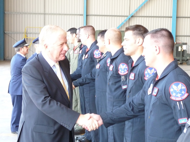 SANTIAGO, Chile -- Mr. Jaime Ravinet de la Fuente, the Chilean Minister of Defense, greets members of the Air Combat Command F-22 Raptor Demonstration