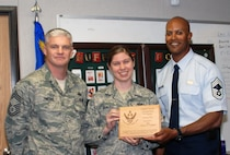 "Staff Sgt. Christy M. Fradette was presented the ""Excellence in Action"" award for February."