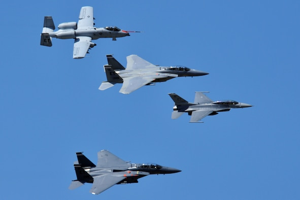 "EGLIN AIR FORCE BASE, Fla. – (top to bottom) A 46th Test Wing A-10 Warthog, F-15C Eagle, F-16 Fighting and an F-15E Strike Eagle perform a formation flyby during the 75th Anniversary Air Show April 11. More than 125,000 were in attendance during the air show April 10-11, enjoying a variety of aerial performances and static displays. This was Eglin's first open house since 2007 and was timed to coincide with the 75th anniversary of the installation. The Thunderbirds, F-22A Raptor demo and ""Tora, Tora, Tora"" were some of the highlights of the event. (U.S. Air Force photo/ Airman 1st Class Anthony Jennings)"