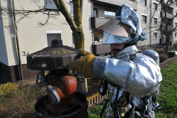 SPANGDAHLEM AIR BASE, Germany – Airman 1st Class Jonathan Douglas, 52nd Civil Engineer Squadron firefighter, connects a water hose to a fire hydrant during a mutual aid exercise at Bitburg Annex April 11. The exercise tested the 52nd Fighter Wing and Bitburg Freiwilige Feuerwehr fire departments' ability to work together and respond to real-world fire emergencies. (U.S. Air Force photo/Airman 1st Class Nick Wilson)