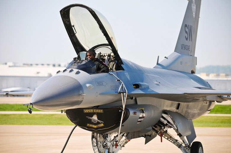 Tech. Sgt. Pierre Julien, a crew chief from the 20th Fighter Wing at Shaw Air Force Base, S.C., configures navigation gear in the cockpit of an F-16 Fighting Falcon while sitting on the flightline of the Kentucky Air National Guard Base in Louisviille, Ky., on April 15, 2010. The aircraft is part of the U.S. Air Force Viper East Demo Team, which is in town to participate in Thunder Over Louisville this weekend. (U.S. Air Force photo by Senior Airman Maxwell A. Rechel)