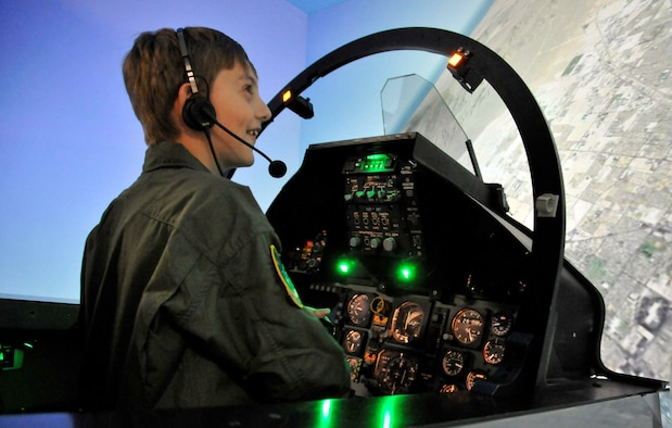 Isaac Ezell takes a ride in an F-15 Eagle simulator April 9, 2010, at the 95th Fighter Squadron while participating in the Pilot for a Day program at Tyndall Air Force Base, Fla. (U.S. Air Force photo/Lisa Norman)