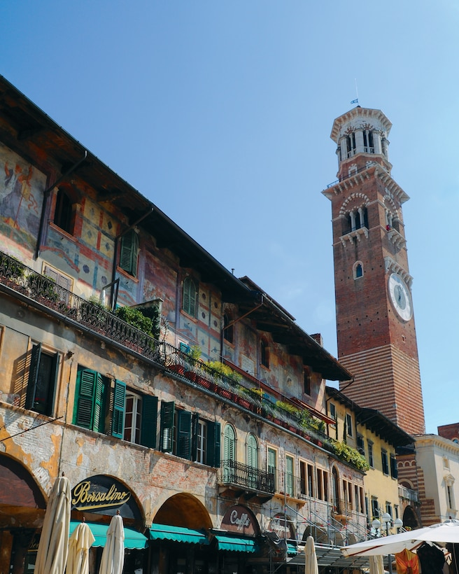 Piazza della Erbe, named for the herbs that grow in the region, was originally the Roman forum, now the central marketplace. The piazza is surrounded by shops, cafes and bars, and is Verona's main gathering place. The Tower Lamberti stands over the square. (U.S. Air Force photo/ Staff Sgt. Taylor L. Marr)