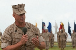 Sergeant Maj. Scott M. Smith, the new Headquarters and Service Battalion, U.S. Marine Corps Forces, Pacific, sergeant major, speaks to his Marines and event attendees, during a post and relief ceremony April 16 at Bordelon Field, Camp H. M. Smith, Hawaii. Smith has worked with the outgoing sergeant major, Sgt. Maj. James Roberts Jr., for the last couple months to ensure his Marines received the quality leadership they deserve.