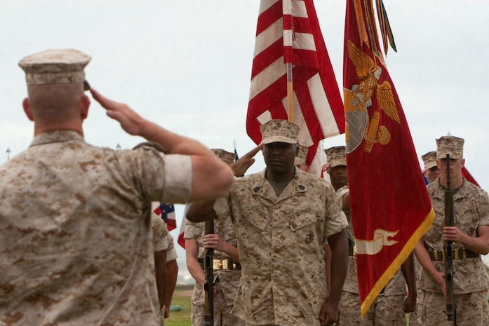 Sergeant Maj. James Roberts Jr., former Headquarters and Service Battalion, U.S. Marine Corps Forces, Pacific, sergeant major, reports to Col. Alan L. Thoma, H&S Bn. commander, during his retirement ceremony April 16 at Bordelon Field, Camp H. M. Smith, Hawaii. Roberts passed his position as battalion sergeant major to Sgt. Maj. Scott M. Smith prior to his retirement.