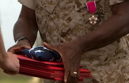 Sergeant Maj. James Roberts Jr., former Headquarters and Service Battalion, U.S. Marine Corps Forces, Pacific, sergeant major, received a Legion of Merit Medal, U.S. flag and several certificates for his nearly 30 years of service April 16 at Bordelon Field, Camp H. M. Smith, Hawaii, during his retirement ceremony. Roberts passed his position as battalion sergeant major to Sgt. Maj. Scott M. Smith prior to his retirement.