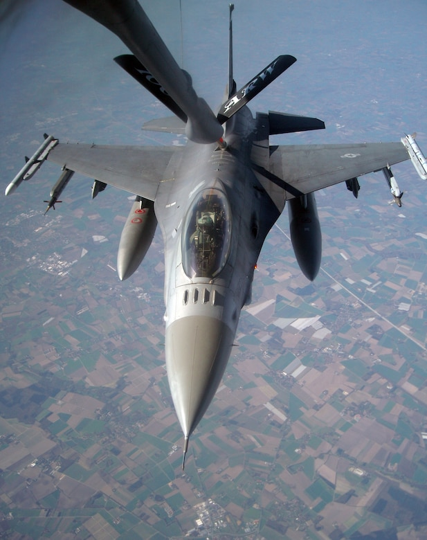 Prior to flying operations being grounded, an F-16 Fighting Falcon from Spangdhalem Air Base, Germany, refuels off a 100th Air Refueling Wing KC-135 Stratotanker during exercise Brilliant Ardent April 15, 2010, at Royal Air Force Mildenhall, England. (U.S. Air Force photo/Tech. Sgt. Kevin Wallace)