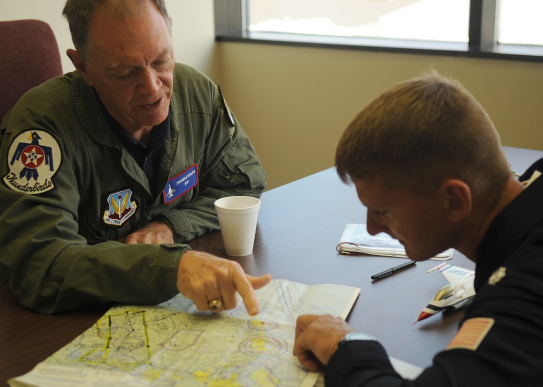 Before his familiarization flight April 15, 2010, at Nellis Air Force Base, Nev., Randy Babbitt (left), the administrator of the Federal Aviation Administration, receives a preflight briefing from Thunderbirds No. 7 pilot Lt. Col. Derek Routt.  (U.S. Air Force photo/Master Sgt. Pam Anderson)