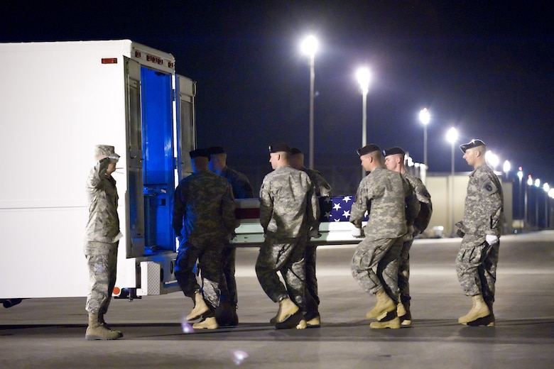 A U.S. Army carry team transfers the remains of Army Pfc. William A. Blount of Petal, Miss., at Dover Air Force Base, Del., on April 9, 2010. He died April 7 in Mosul, Iraq, when enemy forces attacked his vehicle with an improvised explosive device. Blount was assigned to the 1st Battalion, 64th Armor Regiment, 2nd Brigade Combat Team, Fort Stewart, Ga. (U.S. Air Force photo/Jason Minto)