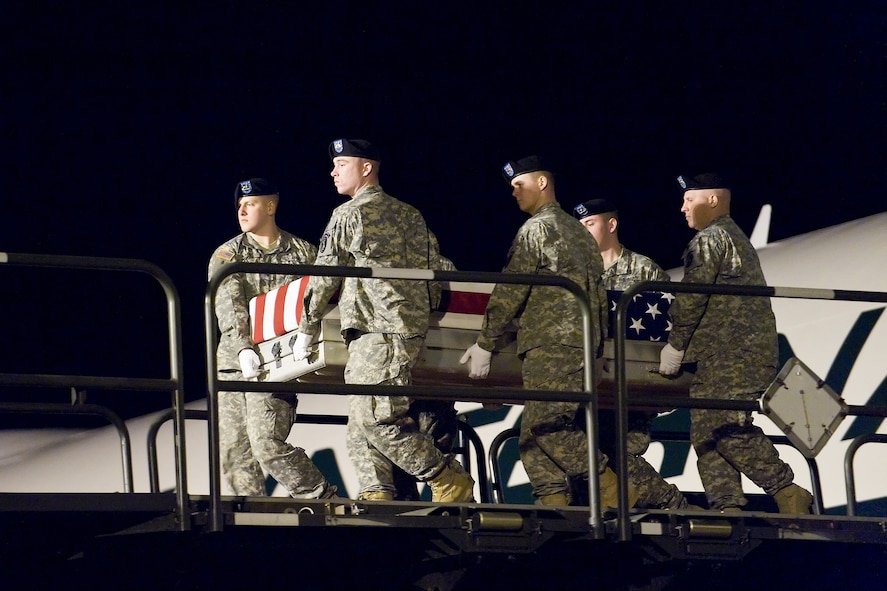 A U.S. Army carry team transfers the remains of Army Spc. Lakeshia M. Bailey, of Columbus, Ga., at Dover Air Force Base, Del., March 10. Spc. Bailey was assigned to 203rd Brigade Support Battalion, attached to the 1st Battalion, 10th Field Artillery Regiment, 3rd Brigade Combat Team, 3rd Infantry Division, Fort Benning, Ga. (U.S. Air Force photo/Roland Balik)